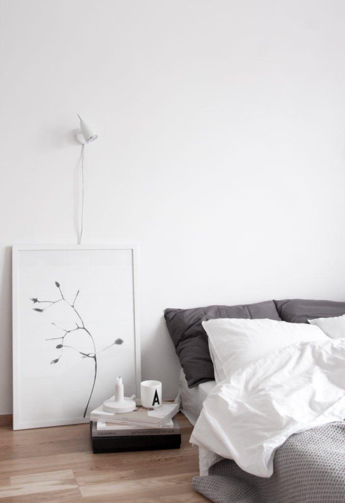 Scandinavian bedroom decordots nighstand books