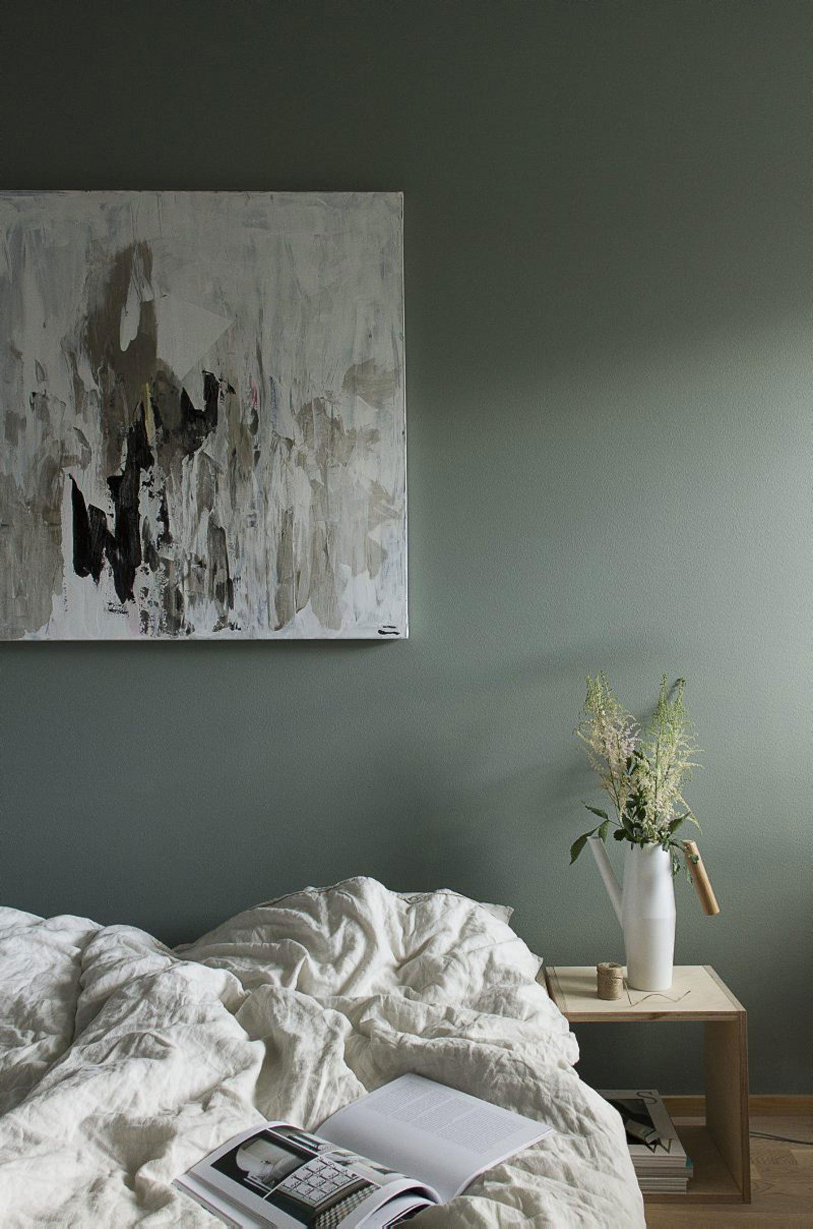 green bed calm cozy scandinavian