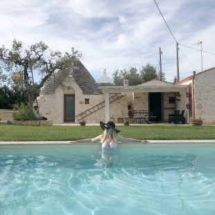 scandinavian feeling trullo puglia italy pool girl