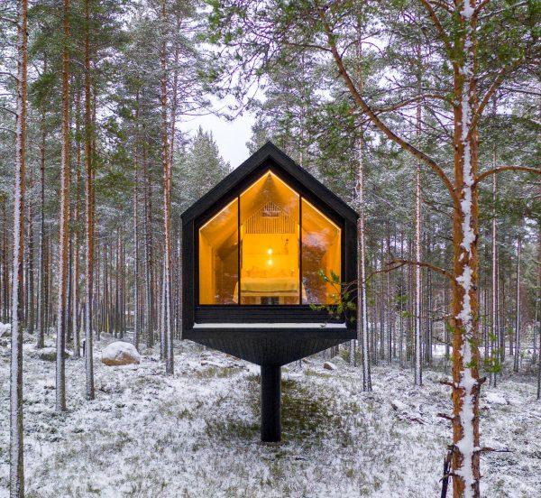 that scandinavian feeling cozy cabin finland forest exterior