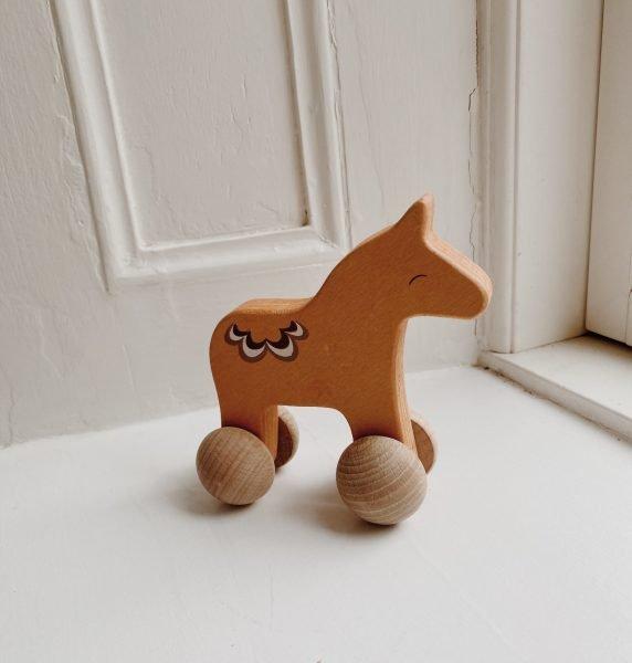 scandinavian feeling nursery decor kids wall wooden horse